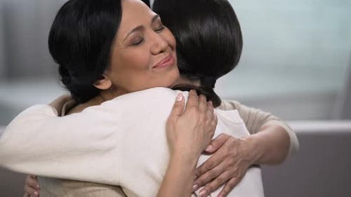 Mother Embracing Young Daughter, Empathy and Tenderness, Love and Maternity