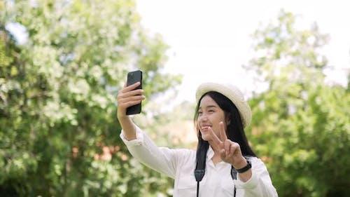 Traveler woman selfie with smartphone
