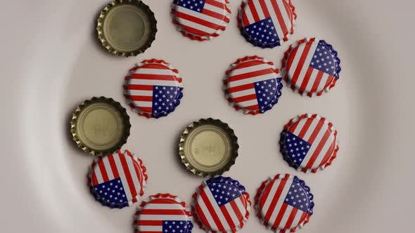 Thumbnail for Rotating shot of bottle caps with the American flag printed on them - BOTTLE CAPS