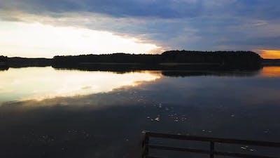 Aerial Shot of  Sunset Over Lake. Kashubia, Lake Wdzydze, Poland.