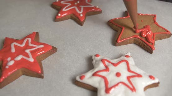 Decoration process of Christmas cookies. Close up of gingerbread star