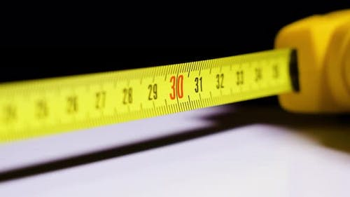 Measuring with Yellow Tape Measure