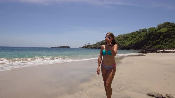 Thumbnail for Girl Walking on the Beach. Bali, Indonesia