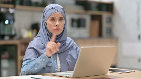 Thumbnail for Arab Woman with Laptop Showing No Gesture, Disapprove