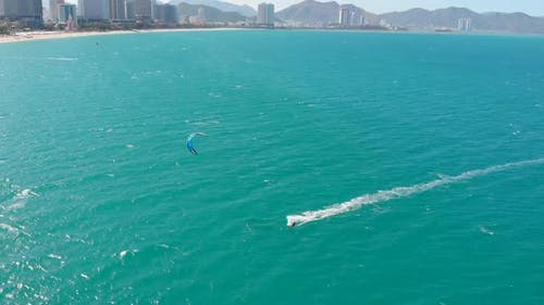 Kitesurfing Place, Sports Concept, Healthy Lifestyle, Human Flight. Aerial View of the City Beach