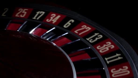 Thumbnail for Part of Roulette Wheel Starts Running, Numbers, Close Up