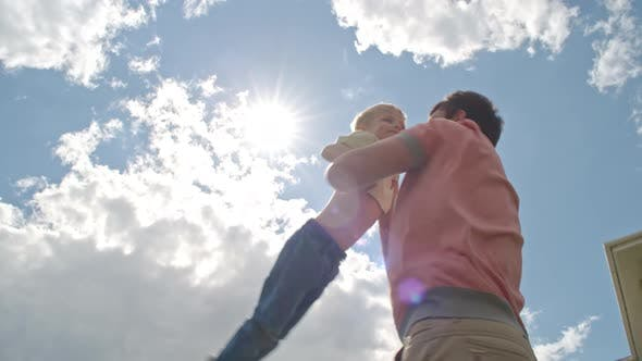 Cover Image for Dad Playing with Happy Child