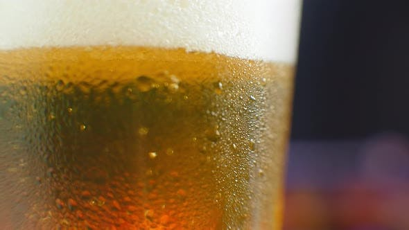 Thumbnail for Beer Closeup. Pint of Cold Craft Beer Isolated on Matte Black Background, Rotation 360 Degrees