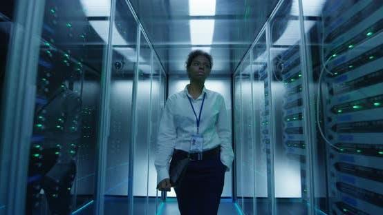 Thumbnail for Woman Walking Among Server Racks