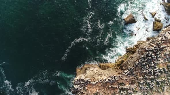 Thumbnail for Aerial View of Agitated Water Hitting Rock Formation