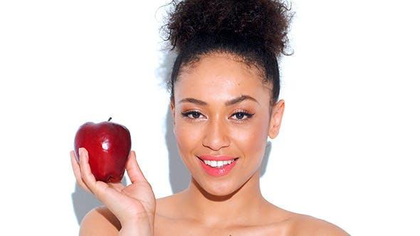 Thumbnail for Smiling Girl Holding Red Apple