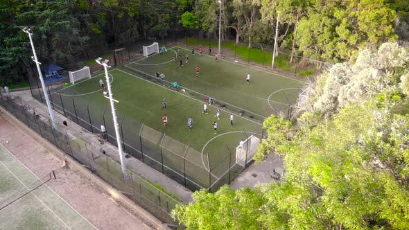 Aerial View. Amateur Training in Mini Football. Teams Compete in Speed and Accuracy.