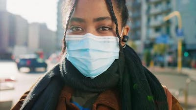 Portrait of young woman in face mask on street, Italy