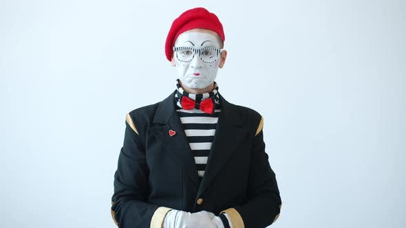 Portrait of Mime Shaking Head Then Waving Finger and Pointing at Screen Meaning Blame and Warning