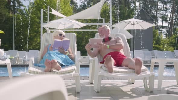 Thumbnail for Adorable Positive Couple Lying on Sunbeds Near the Pool