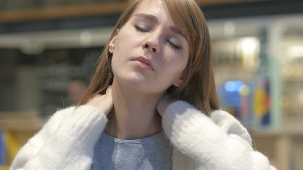 Thumbnail for Young Woman with Serious Neck Pain, Indoor