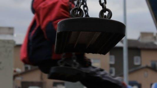 Thumbnail for Boy on Swings