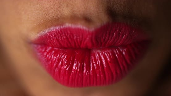 Thumbnail for Closeup of woman pressing lips together