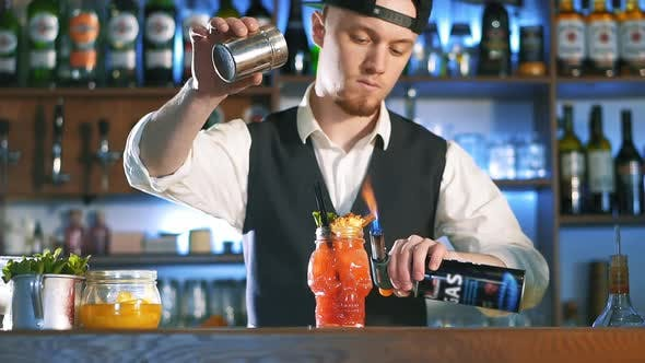 Thumbnail for The Bartender Is Preparing an Alcoholic Cocktail