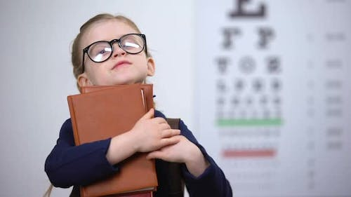 Bookworm Kid in Glasses Hugging Books, Poor Vision After Reading Too Much