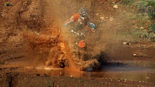 Cover Image for Biker Splashing Mud