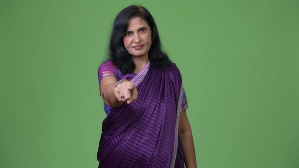 Thumbnail for Mature Beautiful Indian Woman Pointing at Camera While Wearing Sari Traditional Clothes