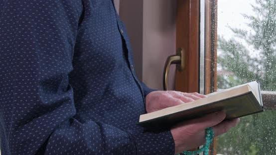 Thumbnail for An Old Muslim Man Reading Koran at Home