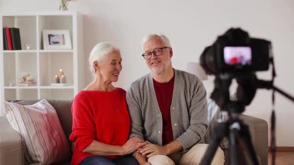 Cover Image for Happy Senior Couple with Camera Recording Video