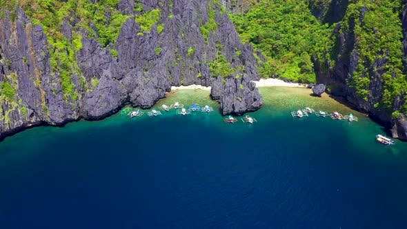 Thumbnail for Tourist Boats at The Beach and Rocks Outside the Secret Lagoon on Miniloc Island in the El Nido
