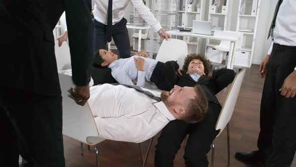 Cover Image for Office Colleagues Playing Human Table Trust Game