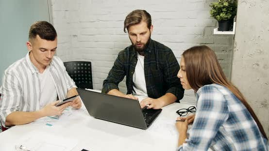 Cover Image for Young Creative Team in Office