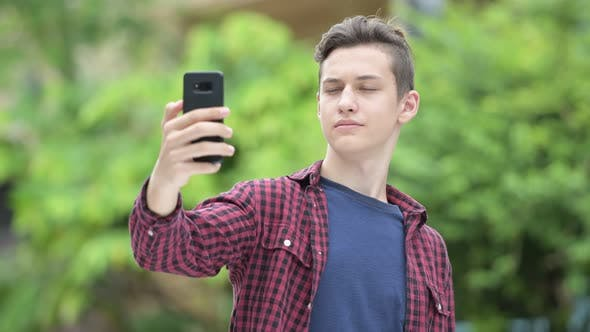 Thumbnail for Young Happy Teenage Boy Taking Selfie Outdoors