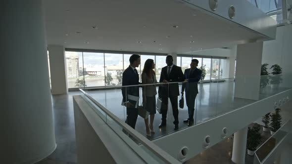 Thumbnail for Business Partners Talking in Modern Office Building