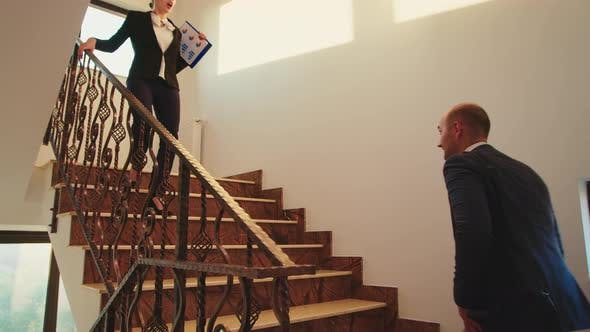 Thumbnail for Business Colleagues Meeting on Stairs and Greeting