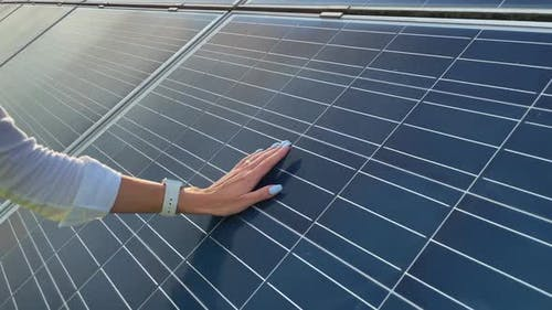Close Up of a Young Woman Engineer Hand is Checking the Operation of Sun and Cleanliness of