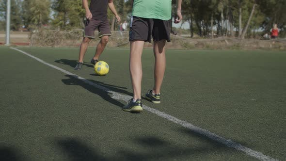 Football Team Players Making Kick-off in the Pitch