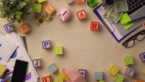 Woman Hand Arranging Wooden Cubes with Word PENSION Top View
