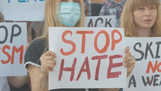 Crowd of Activists Protesting Against Social Inequality on Covid-19 Pandemic. Caucasian People with