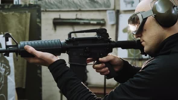 Man Trains To Shoot at the Shooting Range
