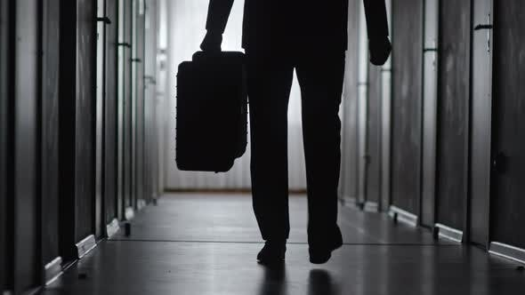 Thumbnail for Silhouette of Businessman Leaving Hotel