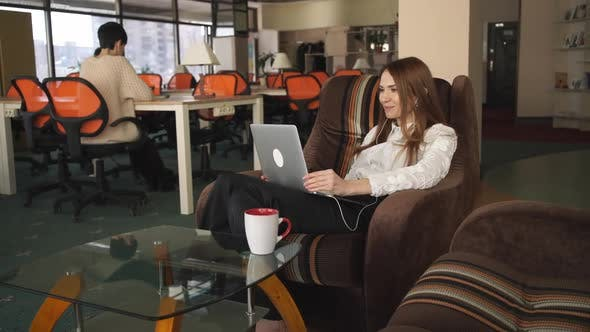 Thumbnail for Happy Businesswoman Using App on Laptop in the Office