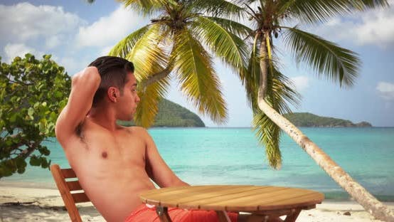 Thumbnail for Millennial Hispanic man on tropical vacation enjoying the sunshine on holiday