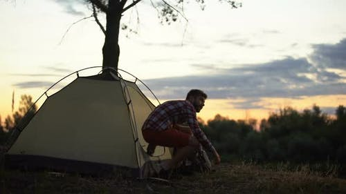 Camper Getting Out of Tent in Morning, Stretching and Yawning, Admiring Scape