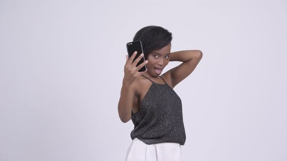Cover Image for Happy Young Beautiful African Woman Video Calling with Phone