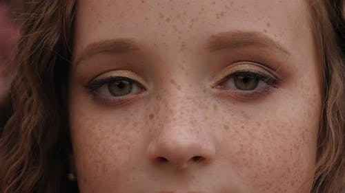 Close-up of a Little Girl's Face with Red Hair and Freckles