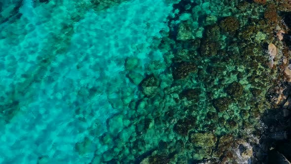 Thumbnail for Aerial View of Crystal Clear Blue Water in Quiet Lagoon on Shore of Cyprus
