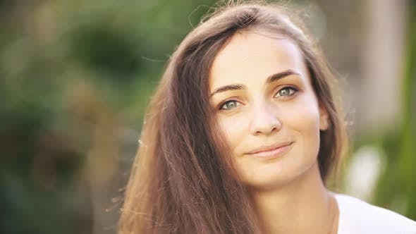 Thumbnail for Portrait of Beautiful Caucasian Woman Smiles and Enjoys of the Moment Isolated on Blur Background
