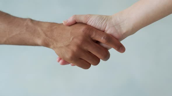 White and Black Hand Connect. Anti-racism. Stop Racism, All People Are Equal. Friendship of People