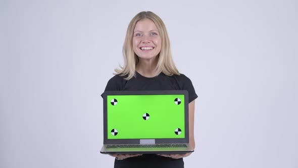 Thumbnail for Young Happy Blonde Woman Showing Laptop and Looking Surprised