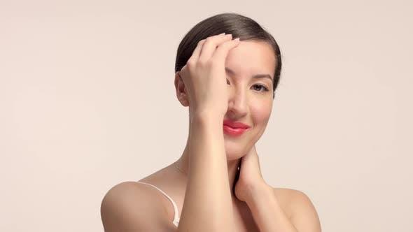 Beauty Brunette Model in Studio Alone with Ideal Shiny Skin Portrait